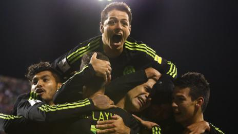 Mexico captain Rafael Marquez (left) is mobbed by team-mates after his side's win