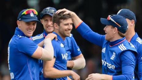 Mark Wood (centre) is congratulated by England team-mates