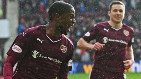 Arnaud Djoum (left) celebrates his goal with Callum Paterson