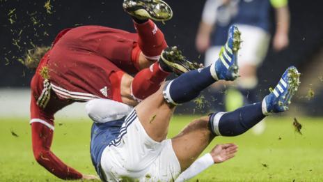 Denmark's Erik Sviatchenko is tackled by Scotland's Liam Bridcutt