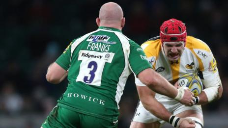 Ben Franks attempts to halt Wasps joint-captain James Haskell in London Irish's 33-15 defeat at Twickenham in November