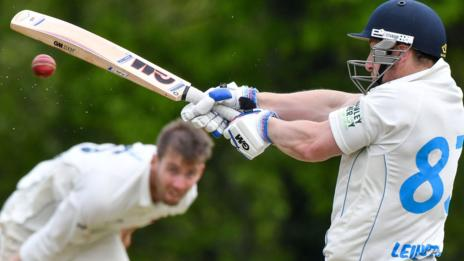 Leinster Lightning's Joe Carroll crashes the ball away against Northern Knights at Stormont
