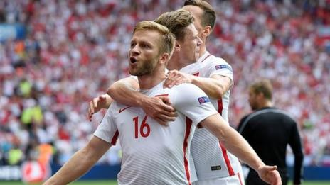 Poland's players celebrate scoring against Switzerland at Euro 2016