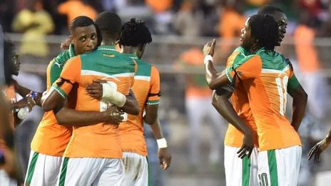 Ivory Coast players celebrate after qualifying for January's Nations Cup.