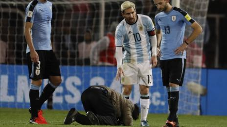 An Aregentina fan kisses the boots of Lionel Messi