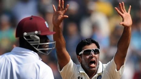 West Indies' Darren Sammy and India's Ravichandran Ashwin