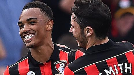 Bournemouth players celebrate the first goal against Everton