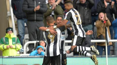 Newcastle's players celebrate Ayoze Perez's early goal against Ipswich