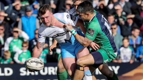 Glasgow full-back Stuart Hogg tries to offload out of a Connacht tackle