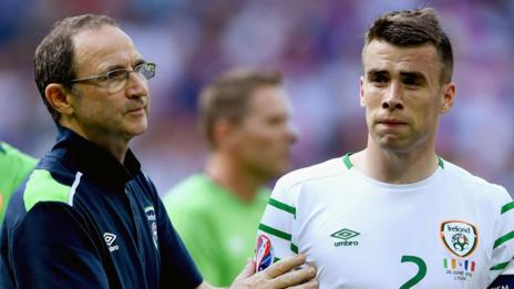 Republic of Ireland manager Martin O'Neill consoles captain Seamus Coleman after France's victory at Euro 2016