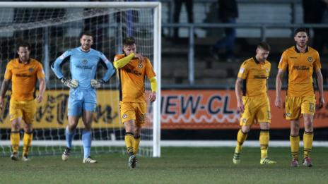 Newport players look dejected during the defeat by Stevenage
