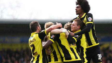 Burton players celebrate Lucas Akins' goal