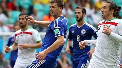 Edin Dzeko looks on as his shot makes it 1-0 to Bosnia-Hercegovina