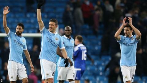 Manchester City players celebrate progress