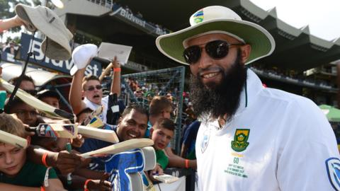 South Africa's Hashim Amla celebrates with supporters