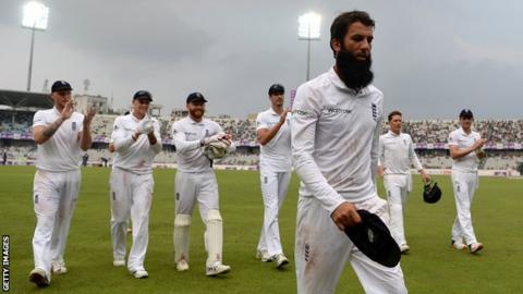 Moeen Ali leads England off the field