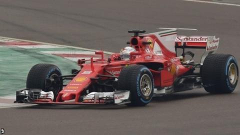Sebastian Vettel steers the new Ferrari SF70H in Maranello, Italy