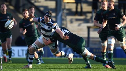 Ben West of Yorkshire Carnegie is tackled by Barney Maddison of Ealing