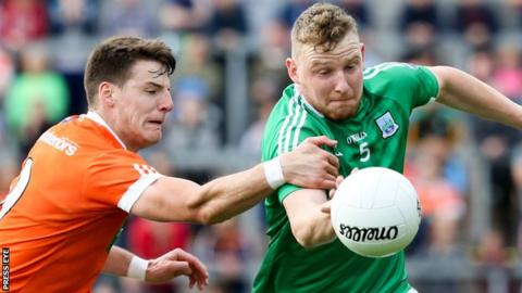 Armagh's Niall Grimley and Fermanagh's Aidan Breen
