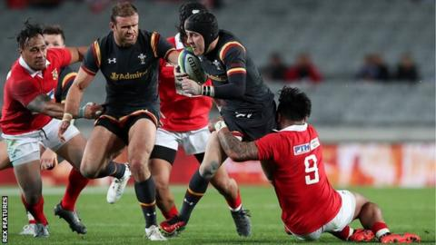 Wales fly-half Sam Davies makes a break against Tonga with Jamie Roberts in support