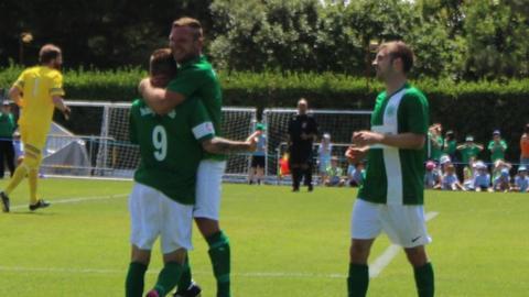 Guernsey celebrate Marc McGrath's penalty