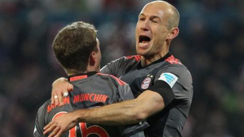 Arjen Robben celebrates scoring for Bayern Munich away to Mainz