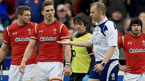 George North (second left) speaks to referee Wayne Barnes during Wales' defeat by France