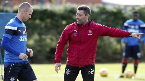Kenny Miller and Pedro Caixinha on the training ground
