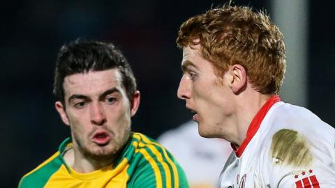 Donegal's Ciaran Gibbons and Tyrone's Peter Harte at Healy Park