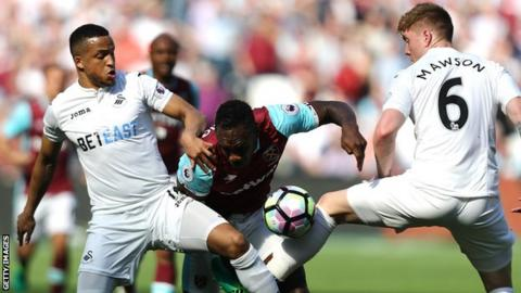 Martin Olsson and Alfie Mawson in action against West Ham's Michail Antonio