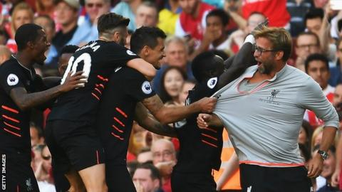 Liverpool manager Jurgen Klopp and his players celebrate beating Arsenal on the opening day of the 2016-17 season