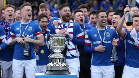 Linfield celebrate winning the Gibson Cup in April after a thrilling title tussle with Crusaders