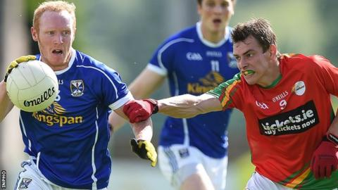 Cavan's Cian Mackey in possession against Sean Gannon of Carlow