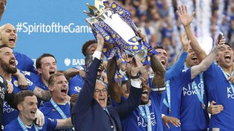 Leicester City lift the Premier League trophy in 2015-16