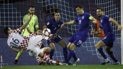 Sokratis Papastathopoulos (19) fails to prevent Nikola Kalinic scoring for Croatia
