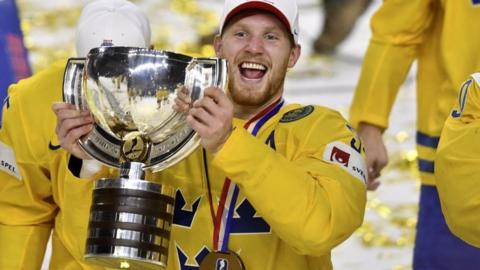 Swedish players celebrate after taking gold