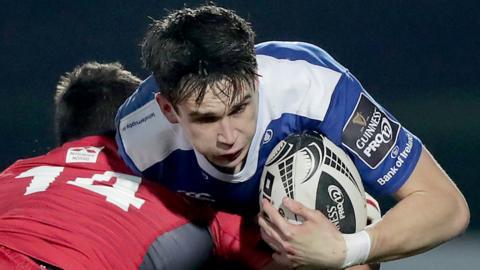 Damien Hoyland of Edinburgh challenges Leinster fly-half Joey Carbery