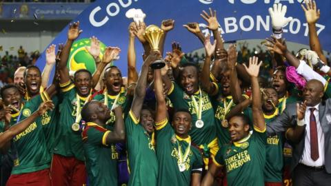 Cameroon's players celebrate winning the Africa Cup of Nations