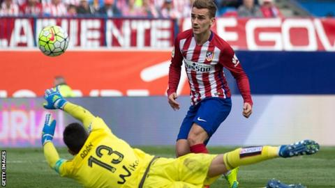 Antoine Griezmann scores one of his two goals for Atletico Madrid against Real Betis