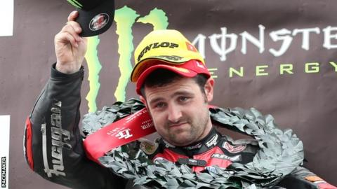 Michael Dunlop celebrates his Supersport victory in the Isle of Man