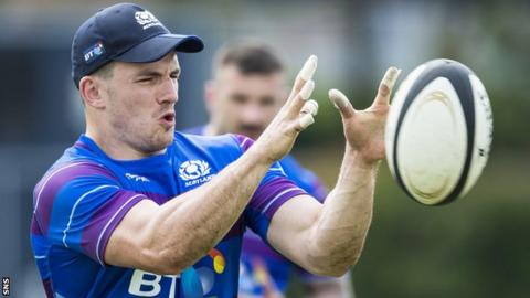 Matt Scott catches the ball during Scotland training