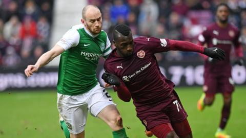 Hibernian's David Gray challenges Hearts' Esmael Goncalves