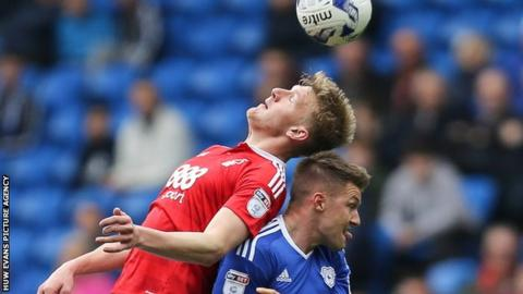 Nottingham Forest's Joe Worrall and Cardiff's Anthony Pilkington tangle at the Cardiff City Stadium