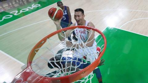Jianlian Yi #11 of China shoots the ball over the United States in the Men's Preliminary Round Group A match on Day 1 of the Rio 2016 Olympic Games at Carioca Arena 1 on August 6, 2016 in Rio de Janeiro, Brazil