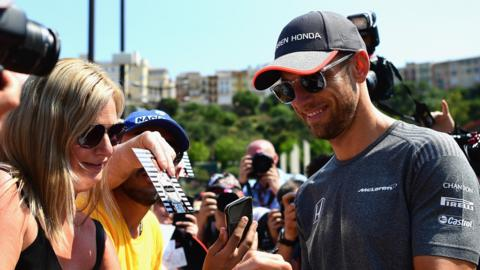 Button meets with fans