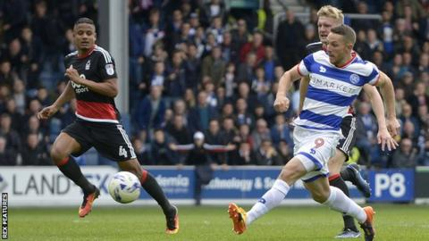 Conor Washington tucks the ball in to give QPR the lead