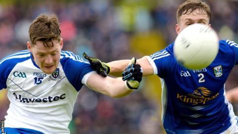 Man-of-the-match Conor McManus shoots as Cavan's Padraig Faulkner attempts to block