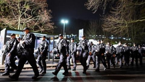 Police forces walk in front of the evacuated HDI Arena prior to the International Friendly match between Germany and Netherlands at HDI Arena