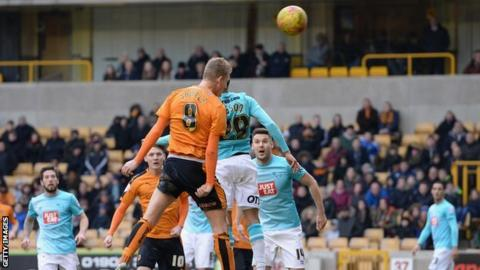 George Saville heads Wolves' winning goal - his second of the game - against Derby County
