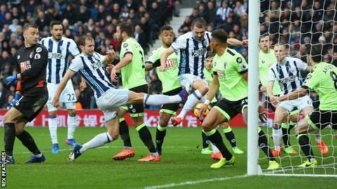 Gareth McAuley (centre) got in just ahead of team-mate Craig Dawson (left) to fire Albion's winner against Bournemouth